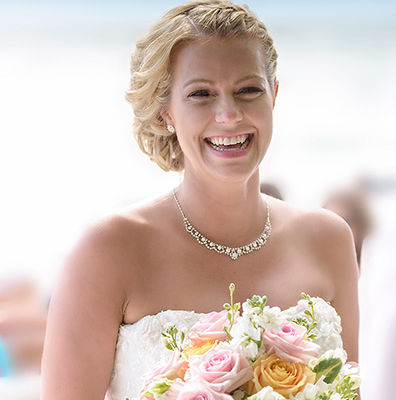 Beautiful bride with all smiles. A beach wedding by Johns & Leena Photography in Naples, FL